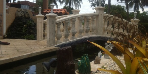 Most beautiful tropical waterfall quotes for Custom koi ponds